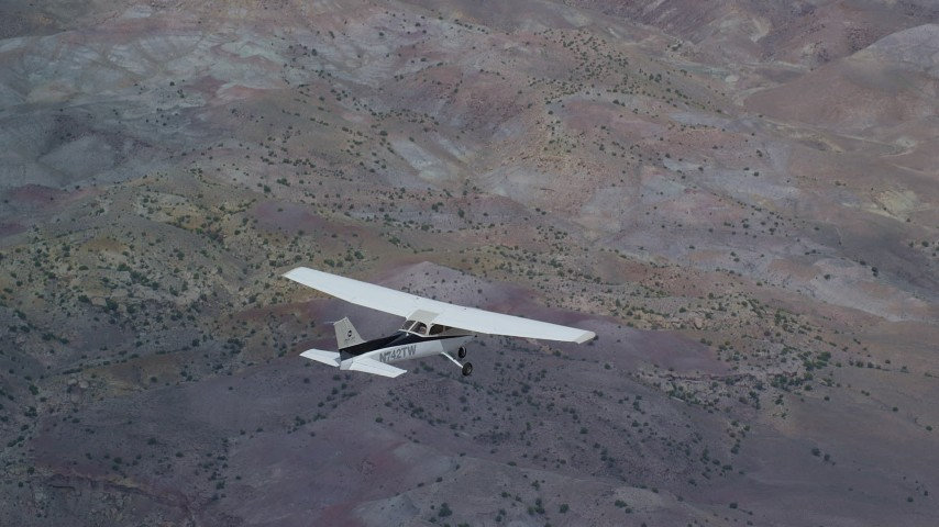 6K stock footage aerial video of tracking Cessna airplane in flight high above desert, Emery County, Utah Aerial Stock Footage | AX139_131