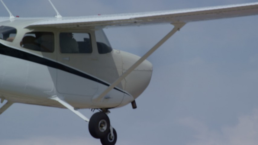 6K stock footage aerial video close-up of Cessna cockpit flying high above desert, Emery County, Utah Aerial Stock Footage | AX139_135