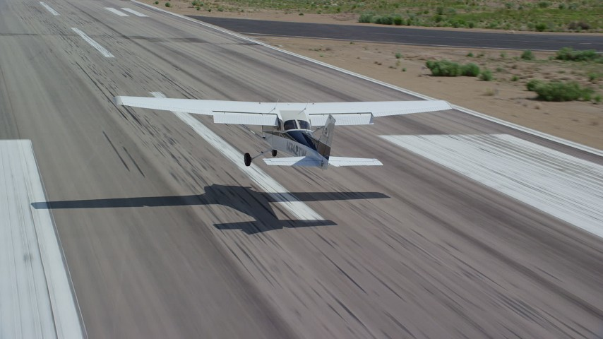 6K stock footage aerial video of a Cessna airplane landing at airport, Buck Davis Field, Utah Aerial Stock Footage AX139_164   Axiom Images