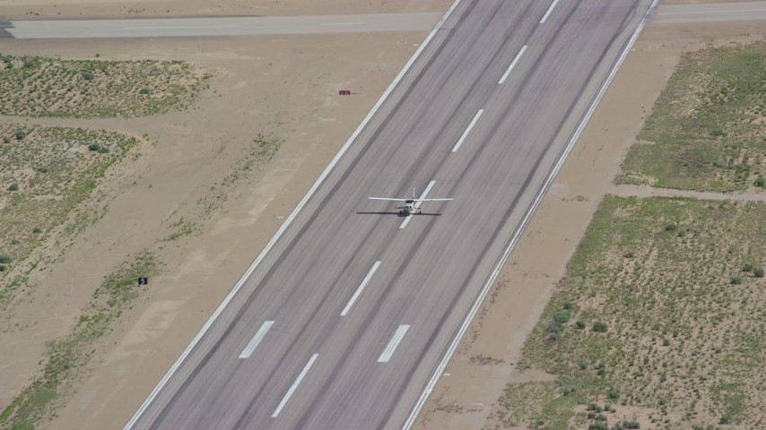 6K stock footage aerial video of tracking a Cessna taking off from airport, Buck Davis Field, Utah Aerial Stock Footage   AX140_001