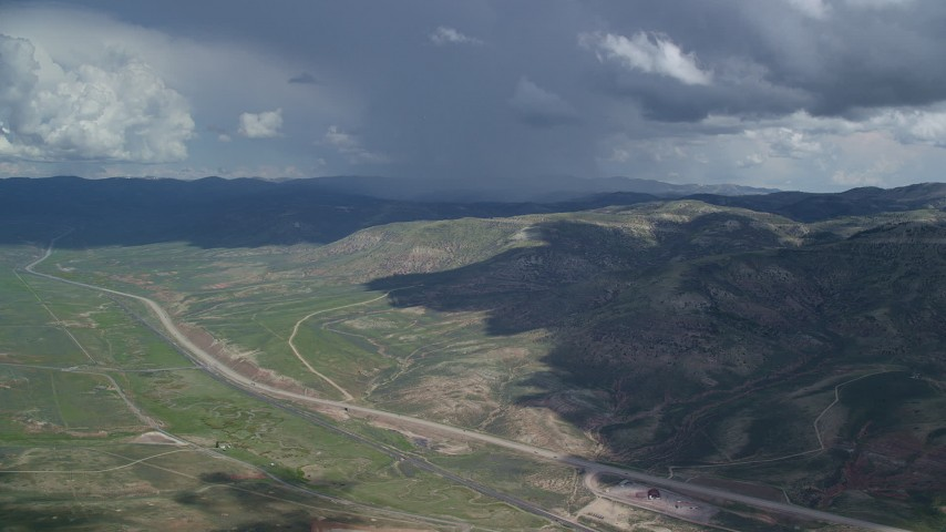6K stock footage aerial video of a wide view of mountains and Highway 6, Colton ghost town, clouds, Wasatch Range, Utah County, Utah Aerial Stock Footage | AX140_038