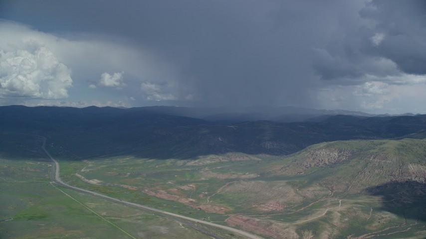 Tracking Tecnam P2006T, rainstorm, Highway 6, Wasatch Range, Utah County, Utah Aerial Stock Footage   AX140_042