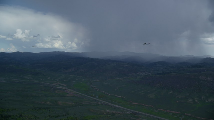 6K stock footage aerial video of tracking Tecnam P2006T and Cessna near rainstorm and Highway 6, Wasatch Range, Utah Aerial Stock Footage | AX140_047