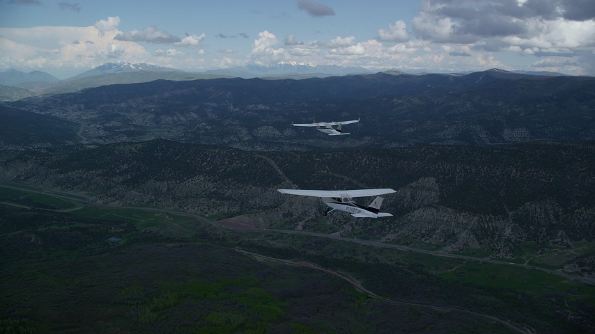 Tecnam P2006T, Cessna, mountains, Highway 6, cloudy, Wasatch Range, Utah Aerial Stock Footage | AX140_058