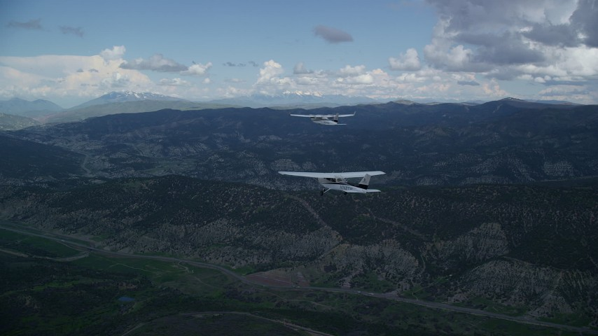 Tecnam P2006T, Cessna, mountains, Highway 6, cloudy, Wasatch Range, Utah Aerial Stock Footage | AX140_059