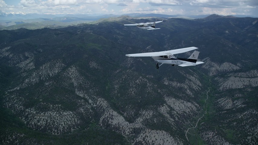 6K stock footage aerial video of flying near a Cessna being led over mountains by Tecnam P2006T, Wasatch Range, Utah Aerial Stock Footage | AX140_071