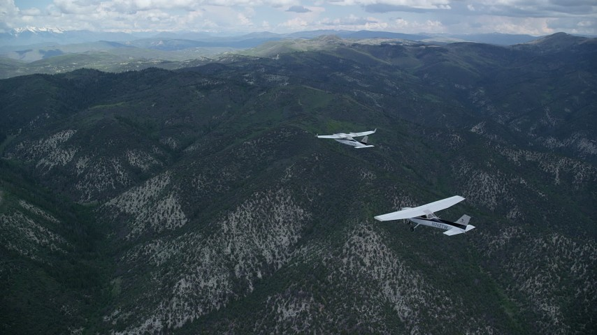 6K stock footage aerial video of tracking a Cessna following a Tecnam P2006T across Wasatch Range, Utah Aerial Stock Footage | AX140_073