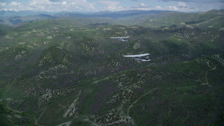 6K stock footage aerial video of tracking a Cessna led by a Tecnam P2006T over mountains, Wasatch Range, Utah Aerial Stock Footage | AX140_079