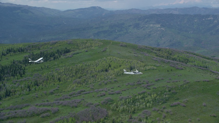 6K stock footage aerial video of Tecnam P2006T and Cessna over mountains and trees in the Wasatch Range, Utah Aerial Stock Footage | AX140_088
