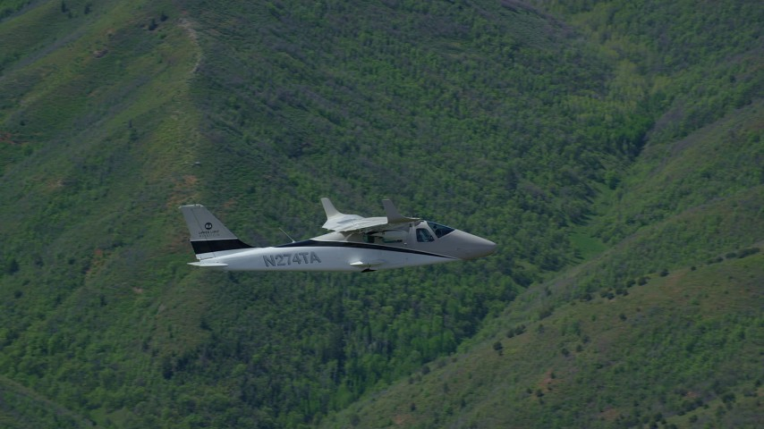 6K stock footage aerial video of tracking a Tecnam P2006T as it flies over mountains, zoom in, Wasatch Range, Utah Aerial Stock Footage | AX140_096