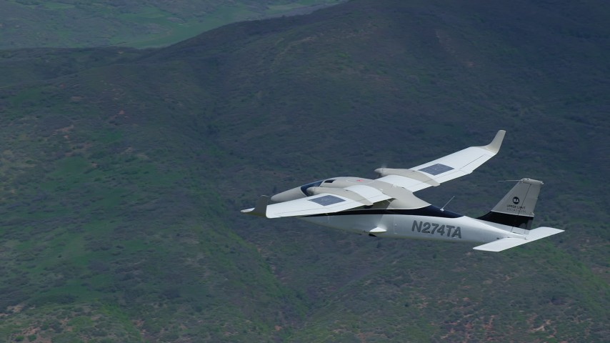6K stock footage aerial video of a close-up view of a Tecnam P2006T over green mountains, Wasatch Range, Utah Aerial Stock Footage | AX140_098