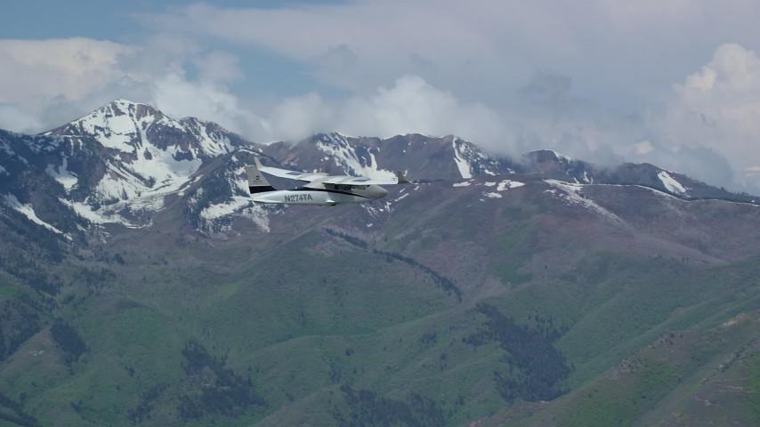 Tecnam P2006T, Coral Mountain, Provo Peak, Freedom Peak, Wasatch Range, Utah Aerial Stock Footage | AX140_103