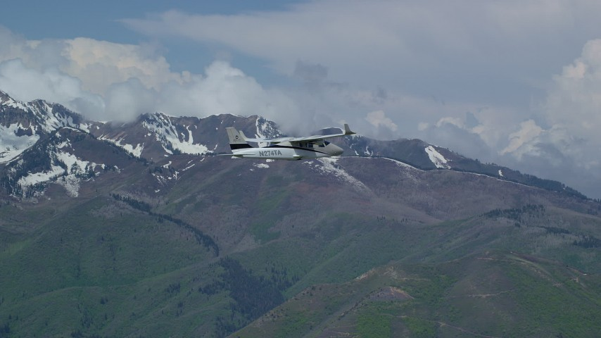 6K stock footage aerial video of a Tecnam P2006T flying near snowy Freedom Peak, Wasatch Range, Utah Aerial Stock Footage | AX140_105