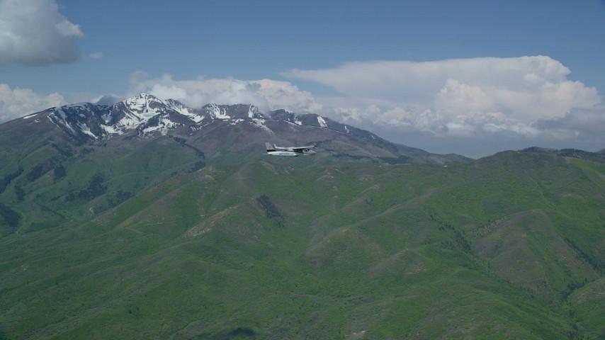 6K stock footage aerial video track Tecnam P2006T in flight near Corral Mountain, Provo Peak, Freedom Peak in Wasatch Range, Utah Aerial Stock Footage   AX140_107