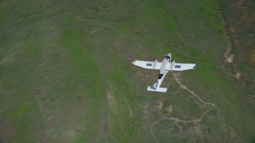 6K stock footage aerial video of flying over a Tecnam P2006T near green mountain ridge, Wasatch Range, Utah Aerial Stock Footage | AX140_112