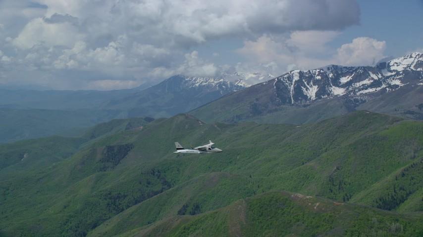 Tracking Tecnam P2006T near Coral Mountain, Wasatch Range, Utah Aerial Stock Footage   AX140_114