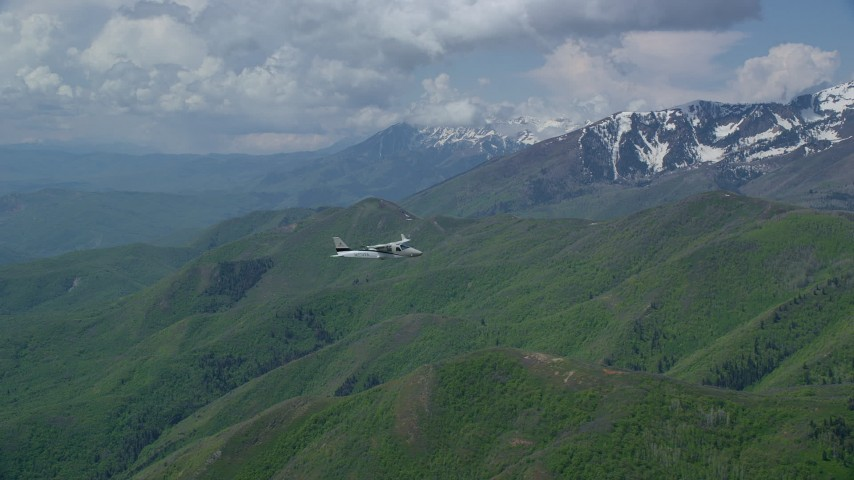Tracking Tecnam P2006T near Coral Mountain, Wasatch Range, Utah Aerial Stock Footage | AX140_114