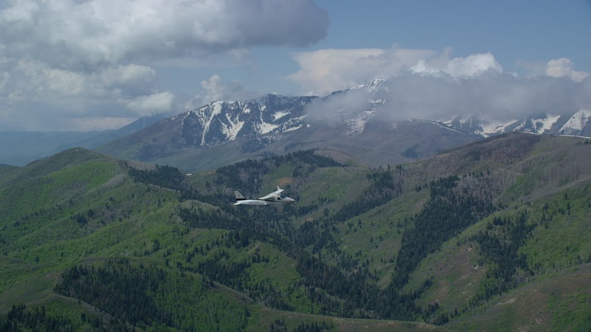 6K stock footage aerial video of a Tecnam P2006T in the air over mountains near snowy peak, Wasatch Range, Utah Aerial Stock Footage | AX140_116