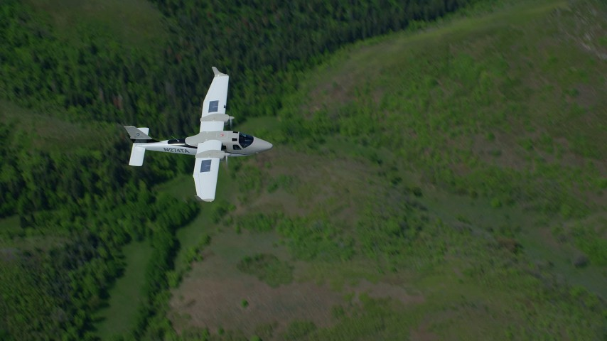 6K stock footage aerial video of a bird's eye view of a Tecnam P2006T airplane flying over mountains, Wasatch Range, Utah Aerial Stock Footage | AX140_118