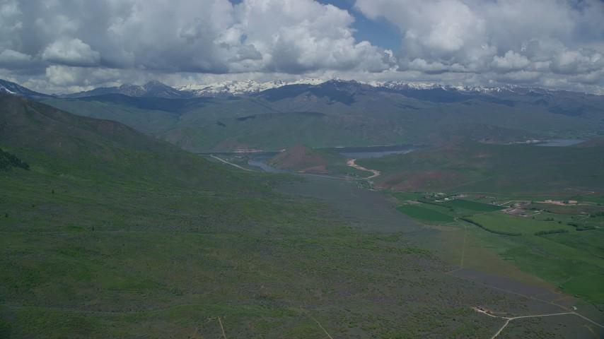 6K stock footage aerial video of approaching reservoir and green mountains, Deer Creek Reservoir, Utah Aerial Stock Footage | AX140_155