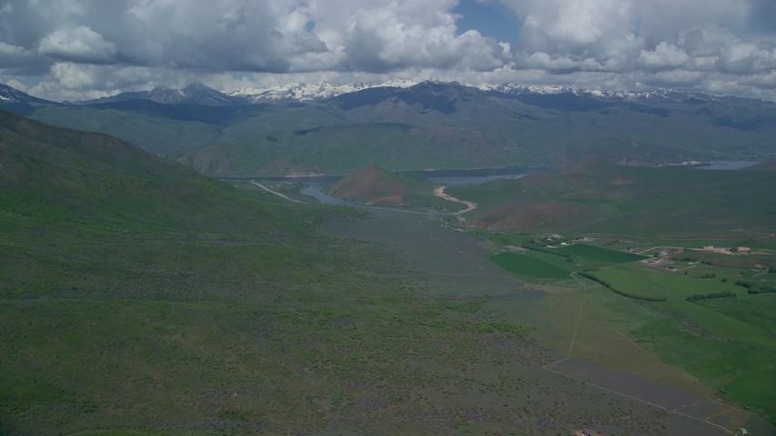 Approach reservoir, mountains, reveal Tecnam P2006T, Deer Creek Reservoir, Utah Aerial Stock Footage | AX140_156