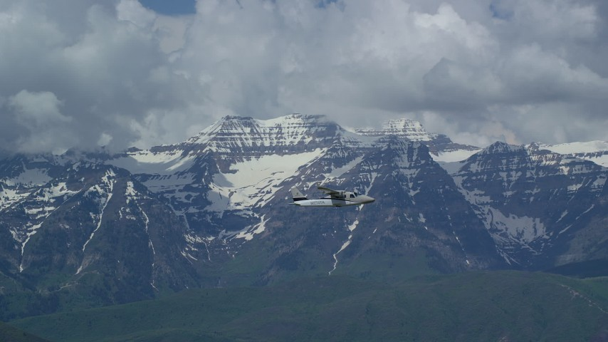 6K stock footage aerial video of focusing on a  Tecnam P2006T passing by snow-capped Mount Timpanogos, Utah Aerial Stock Footage | AX140_166