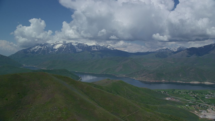 Flying by Deer Creek Reservoir, snow-capped Mount Timpanogos, Utah Aerial Stock Footage | AX140_171