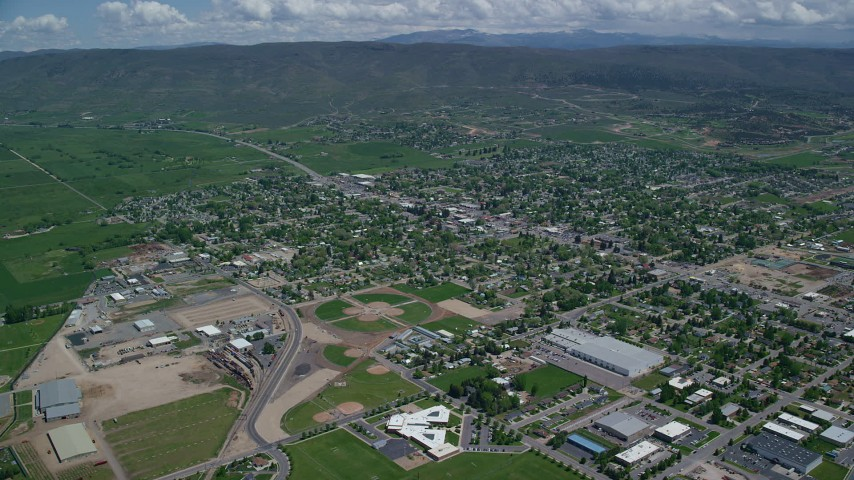 6K stock footage aerial video of small town neighborhoods with baseball fields, Heber City, Utah Aerial Stock Footage | AX140_177