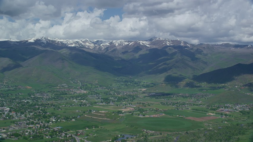 6K stock footage aerial video of snowy peaks seen from small town of Midway, Wasatch Range, Utah Aerial Stock Footage | AX140_178