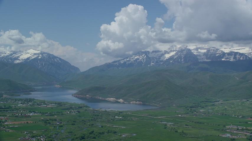 Flying by snowy Mount Timpanogos, Deer Creek Reservoir, Midway, Utah Aerial Stock Footage | AX140_180