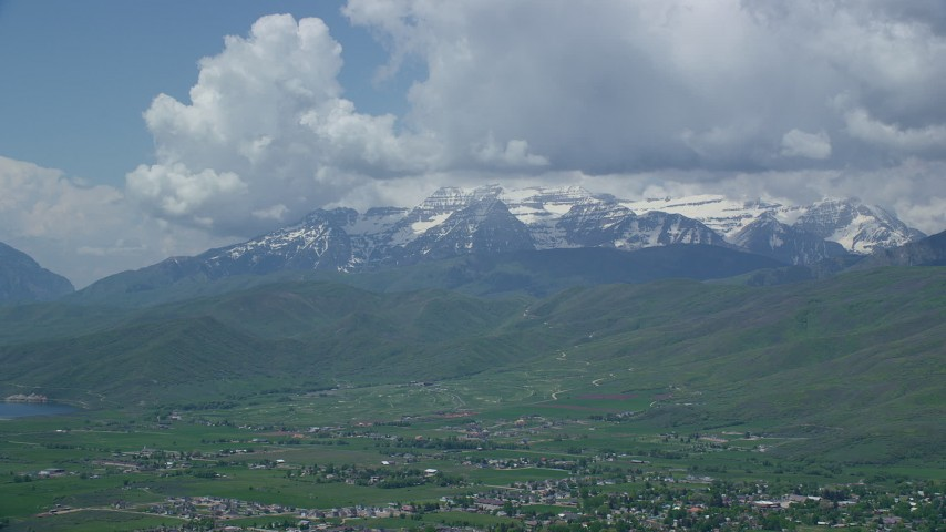 6K stock footage aerial video of snow-capped Mount Timpanogos seen from town of Midway, Utah Aerial Stock Footage | AX140_183