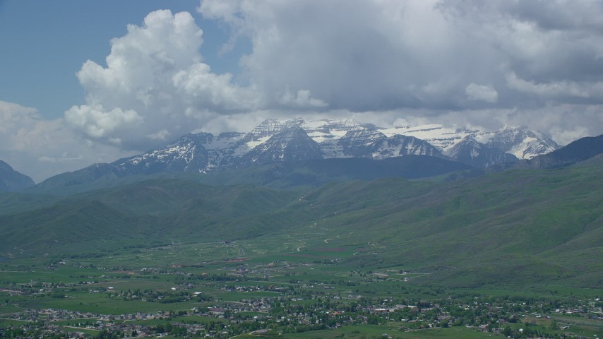 Flying by snow-capped Mount Timpanogos, from over Midway, Utah Aerial Stock Footage | AX140_184