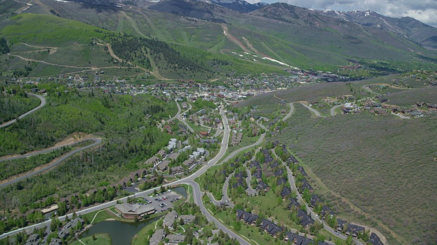 6K stock footage aerial video of passing waterfront condos, small lakes near the center of Park City, Utah Aerial Stock Footage | AX140_200