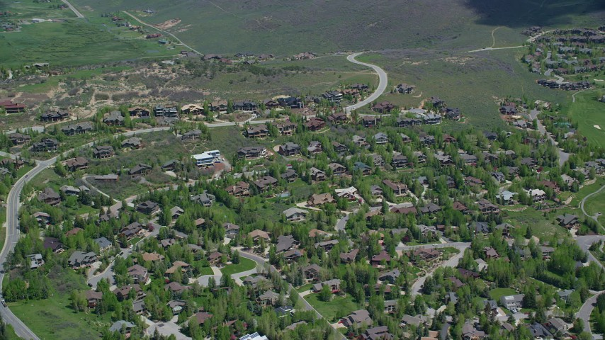 6K stock footage aerial video of a small town neighborhood with upscale homes, Park City, Utah Aerial Stock Footage   AX140_206