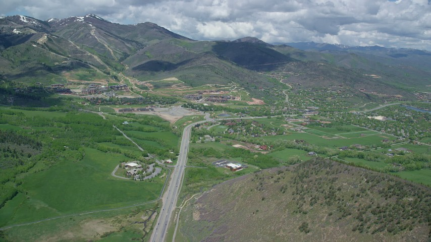 Follow State Route 224, approach Canyons Resort, neighborhoods, Park City, Utah Aerial Stock Footage | AX140_207