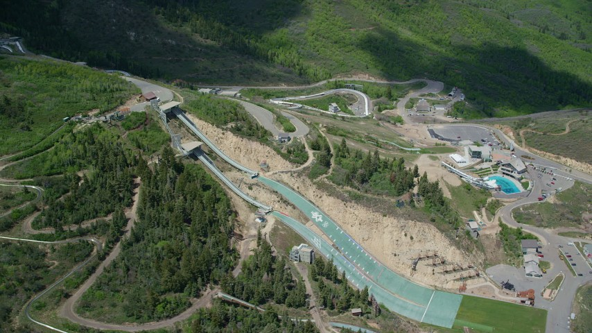 6K stock footage aerial video of the aerials pool and ski jumps at Utah Olympic Park Aerial Stock Footage | AX140_219