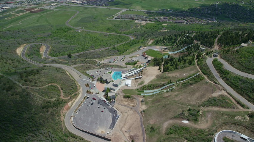 6K stock footage aerial video of flying away from aerials pool at Utah Olympic Park Aerial Stock Footage | AX140_222