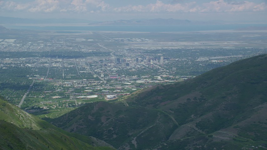 Flying over Wasatch Range, approaching Downtown Salt Lake City, Utah Aerial Stock Footage | AX140_240