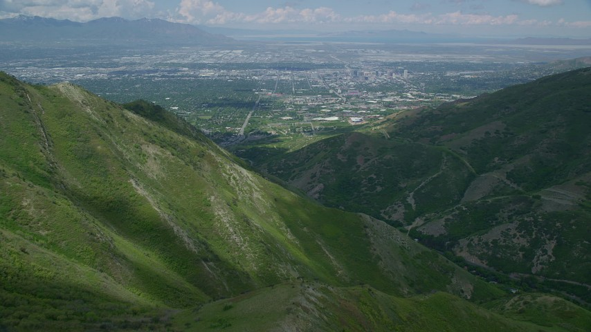 Flying over Wasatch Range, approaching Downtown Salt Lake City, Utah Aerial Stock Footage | AX140_241
