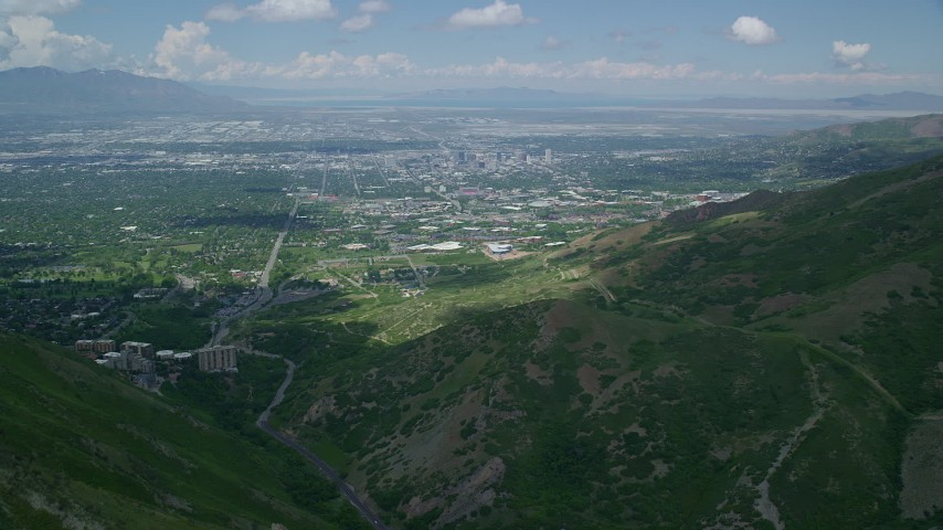 6K stock footage aerial video of flying over Wasatch Range toward University of Utah, Downtown Salt Lake City, Utah Aerial Stock Footage | AX140_242