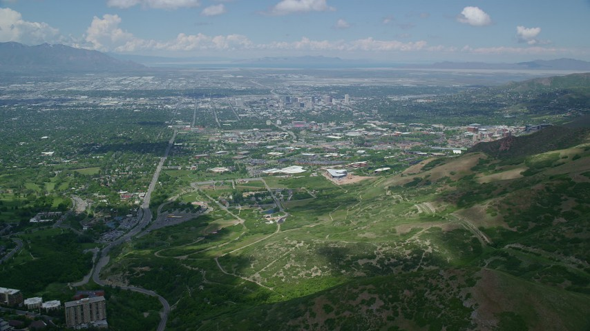 Flying over Wasatch Range to University of Utah, Downtown Salt Lake City, Utah Aerial Stock Footage | AX140_243
