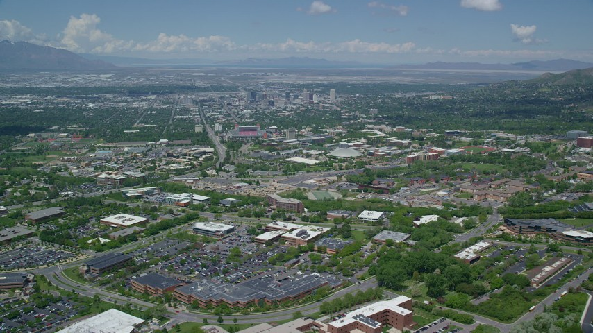 6K stock footage aerial video of flying over University of Utah to approach Downtown Salt Lake City, Utah Aerial Stock Footage | AX140_246
