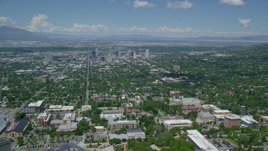 6K stock footage aerial video of flying over University of Utah and toward Downtown Salt Lake City, Utah Aerial Stock Footage | AX140_249
