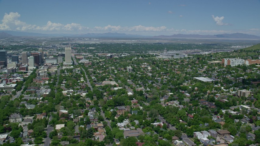 Flying over neighborhoods, Utah State Capitol Aerial Stock Footage | AX140_252