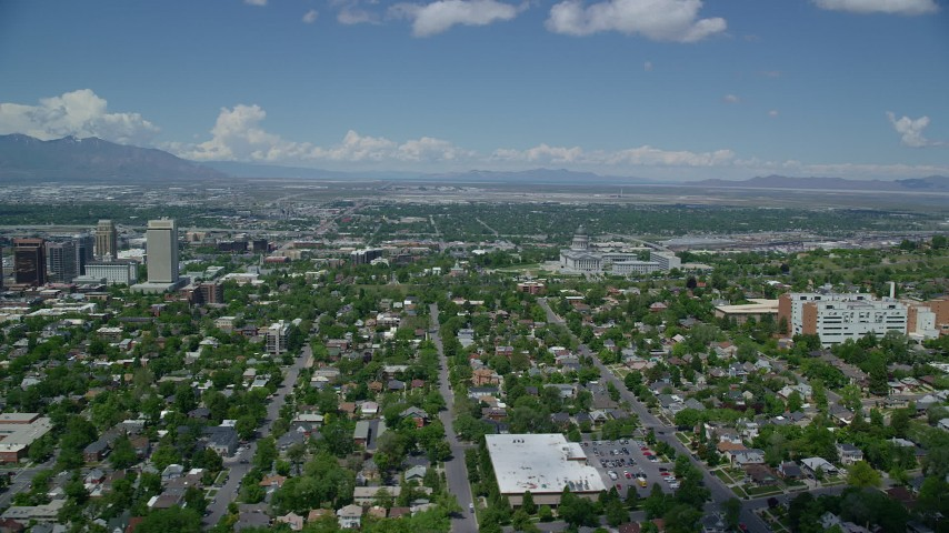 Flying over neighborhoods, Utah State Capitol Aerial Stock Footage | AX140_253