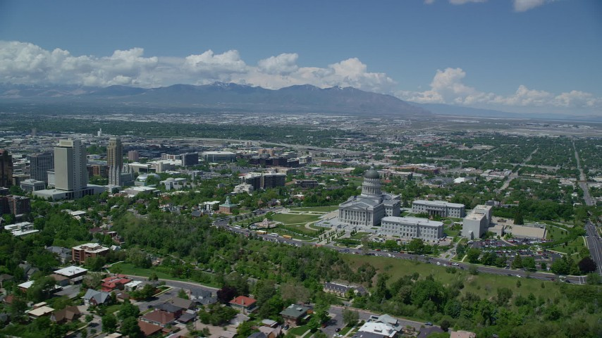 Flying over neighborhoods, by Utah State Capitol, Downtown Salt Lake City, Utah Aerial Stock Footage | AX140_254
