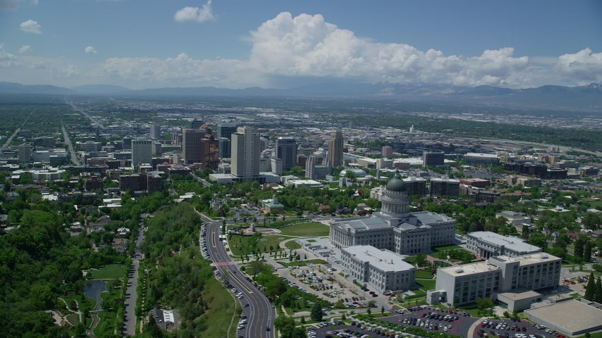 Flying by Utah State Capitol and Downtown Salt Lake City, Utah Aerial Stock Footage | AX140_255
