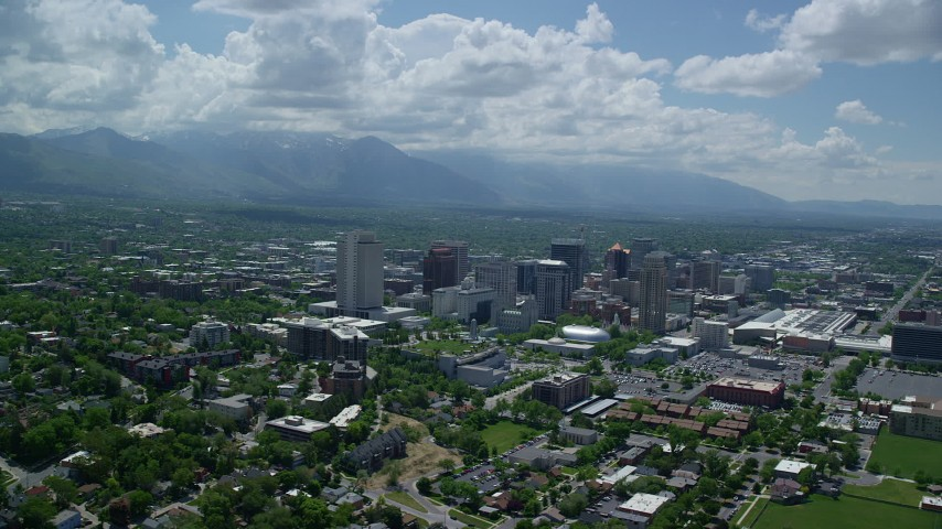 6K stock footage aerial video of a view of downtown and Wasatch Range in the distance, Downtown Salt Lake City, Utah Aerial Stock Footage | AX140_257