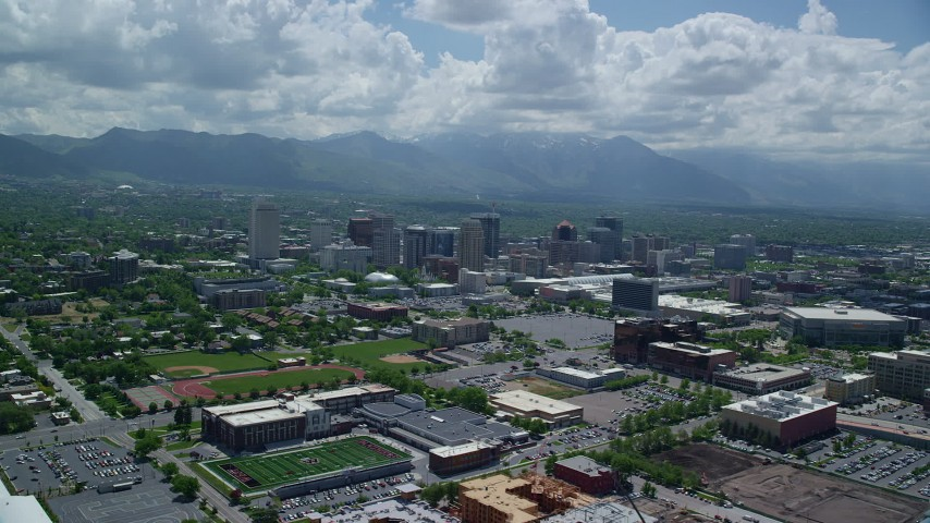 Fly away from Downtown, distant Wasatch Range, Downtown Salt Lake City, Utah  Aerial Stock Footage | AX140_259