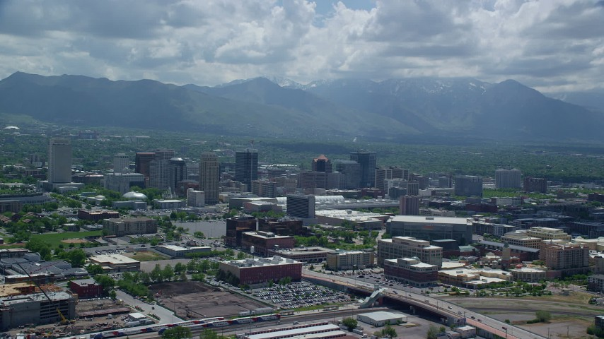 6K stock footage aerial video reverse view of downtown and distant Wasatch Range, Downtown Salt Lake City, Utah Aerial Stock Footage | AX140_260